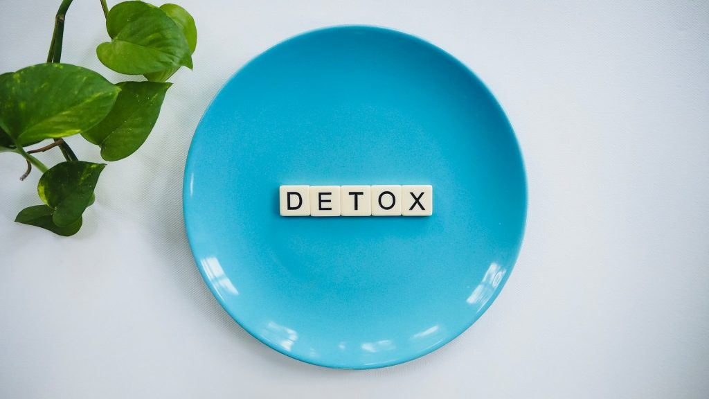 Blue plate with letter tiles that read, DETOX